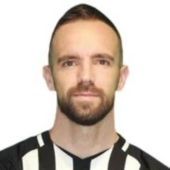 J. Scuk