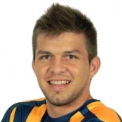 M. Báez