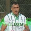 E. González