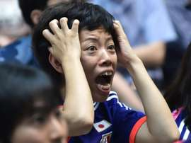 A Japanese football fan reacts as she watches the Women World Cup final between Japan and the US at a public screening in Tokyo on July 6, 2015