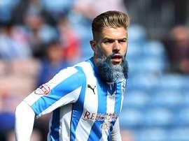 Adam Clayton, futbolista con una barba cuando menos peculiar.
