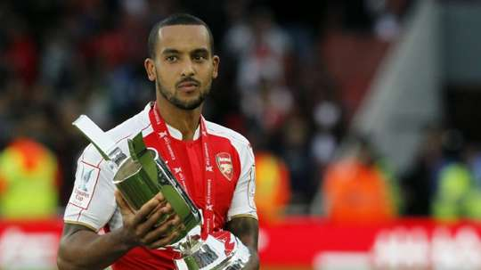 Arsenal's midfielder Theo Walcott poses with the Emirates cup after winning a pre-season friendly match against Wolfsburg at The Emirates Stadium in north London on July 26, 2015