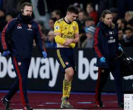 Kieran Tierney will be out for a few months after injuring his shoulder at West Ham. AFP