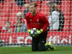 Liverpools goalkeeper Loris Karius warms up ahead of the English Premier League football match against Hull City at Anfield September 24, 2016