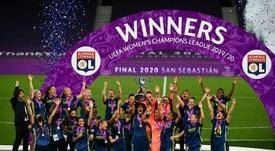 Lyon skipper Wendie Renard lifts the trophy after her team beat Wolfsburg. AFP