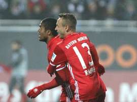Bayern Munich midfielder Douglas Costa celebrates after scoring with Rafinha. AFP