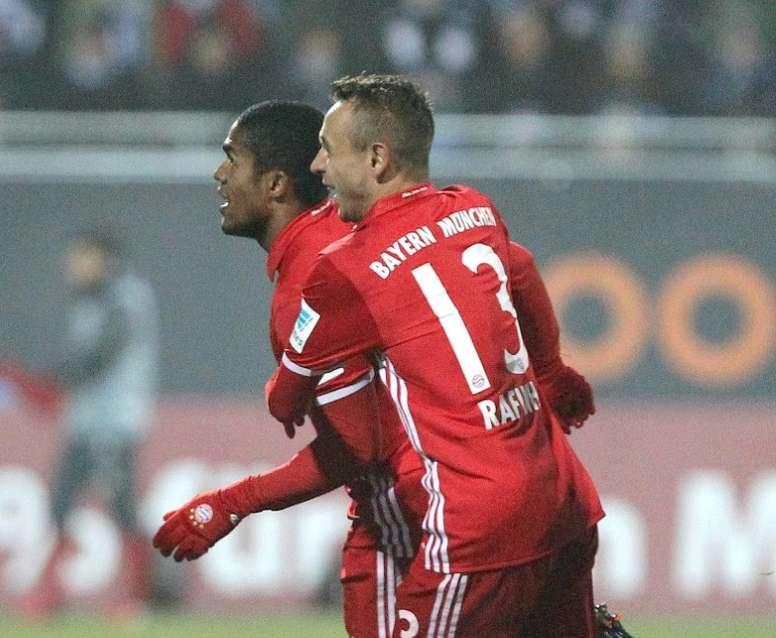 Bayern Munich midfielder Douglas Costa celebrates after scoring with Rafinha. AFP