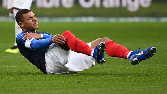 Mbappe went off in pain. AFP