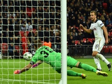 Harry Kane (R) scores past CSKA Moscow goalkeeper Igor Akinfeev. AFP