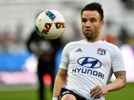 Mathieu Valbuena warms up whilst playing for Lyon