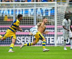 Parma businessmen increase share in club celebrates scoring against Inter Milan. AFP
