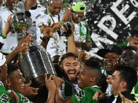 Colombias Atletico Nacional players celebrate with the trophy after winning the 2016 Copa Libertadores at Atanasio Girardot stadium