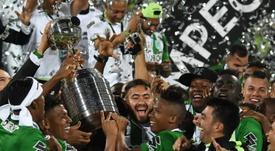 Colombias Atletico Nacional players celebrate with the trophy after winning the 2016 Copa Libertadores at Atanasio Girardot stadium