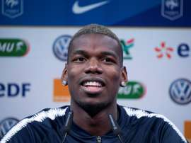 Pogba has praised both Real and Barca. AFP