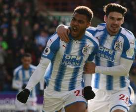 Mounie bagged a brace in an important win for Huddersfield. AFP