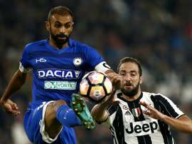 Udinese defender and captain Danilo Larangeira (L) challenges Juventus forward Gonzalo Higuain for the ball during the Italian Serie A match at the Juventus Stadium in Turin on October 15, 2016