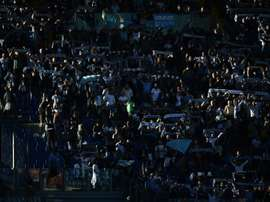 SS Lazios fans cheer prior an Italian Serie A football match at the Olympic Stadium in Rome on November 8, 2015