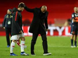 Henry consoled his players at the end of a defeat to Montpellier that he said was a disaster. AFP