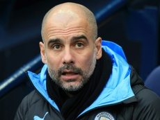 Pep Guardiola reassured fans that he'll stay at Man C. AFP