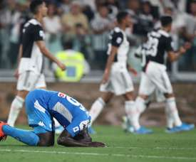 Koulibaly's own goal meant Napoli lost 4-3 after fighting back from 3-0 down v Juve. AFP