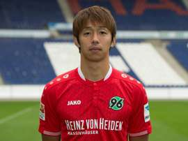 Hanovers Japanese midfielder Hiroshi Kiyotake poses during a new photocall of German first division Bundesliga football team Hannover 96 on September 17, 2015. AFP PHOTO / DPA / JULIAN STRATENSCHULTE +++ GERMANY OUT