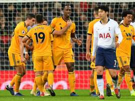 Willy Boly (c) levelled for Wolves at Wembley. AFP