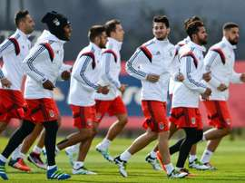 Benficas players run during a training session on April 12, 2016