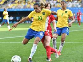 Marta in action during Brazil's bronze medal match against Canada. AFP