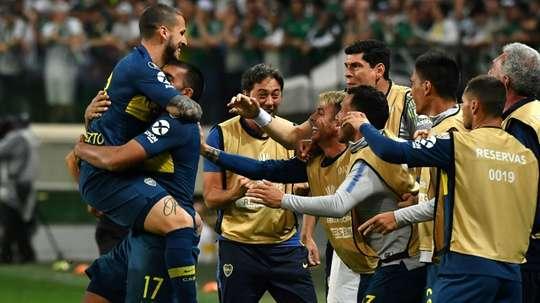 Dario Benedetto (left) celebrates scoring a goal against Palmeiras. AFP