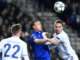 Leicester City defender Robert Huth (C) vies with FC Copenhagen defender Erik Johansson. AFP