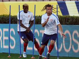 Kyle Beckerman (R) of the USA football team runs during a training session at the Rose Bowl in Pasadena, California, on October 9, 2015