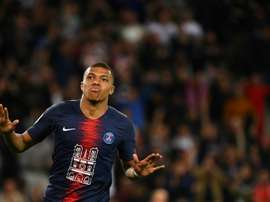 Kylian Mbappe scored a hat-trick against his old team. AFP