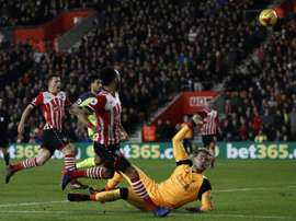 Southamptons Nathan Redmond (C) chips the ball over Liverpools goalkeeper Loris Karius during their EFL (English Football League) Cup semi-final first-leg match, at St Marys Stadium in Southampton, on January 11, 2017
