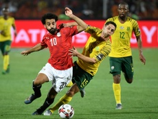 Mohamed Salah (L) and Dean Furman of South Africa. AFP