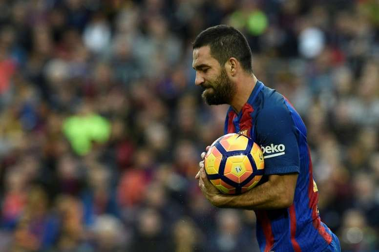 Arda Turan's Barça dream is over. AFP