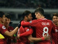 Brazilian duo Oscar and Hulk's side failed to win the league. AFP