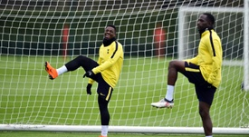 Serge Aurier and Moussa Sissoko are in trouble after an Instagram video. AFP