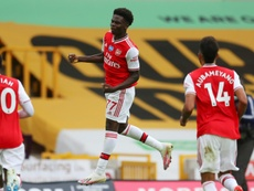 Bukayo Saka (C) scored for Arsenal in a 0-2 win at Wolves. AFP