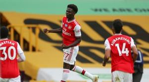 Bukayo Saka (C) scored for Arsenal in a 0-2 win at Wolves. AFP