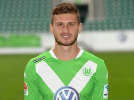 Wolfsburgs Polish midfielder Mateusz Klich poses for a photograph during the official presentation of German first division Bundesliga football team VfL Wolfsburg in Wolfsburg, central Germany on July 30, 2014