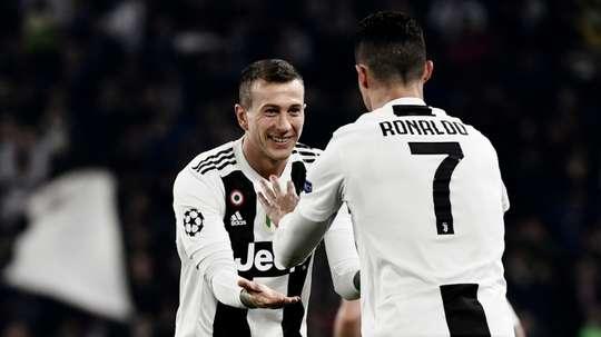 Bernadeschi with teammate Cristiano Ronaldo. AFP
