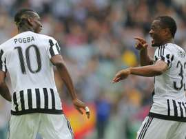 Juventus midfielder Paul Pogba (L) celebrates after scoring with teammate and fellow Frenchman Patrice Evra during the Italian Serie A match against Palermo at the Juventus stadium in Turin on April 17, 2016