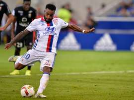 Lacazette takes a penalty in Lyon's win over Caen. AFP
