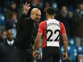 Guardiola regrets his on-field conversation with Redmond. AFP