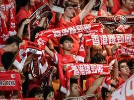 Local football fans watch a 2018 World Cup qualifying match, Hong Kong vs Qatar, in Hong Kong, on September 8, 2015