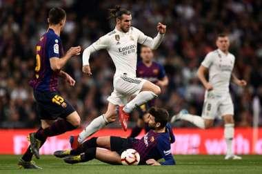 Horario y donde ver el Real Madrid y el Barça. AFP