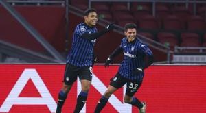Muriel goal books Atalanta spot in last 16. AFP
