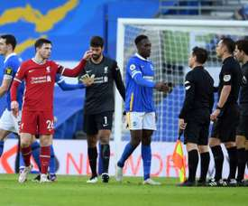 Liverpool defender Andrew Robertson complains to the officials. AFP