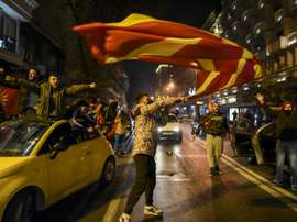 North Macedonia supporters poured into the streets of Skopje. AFP