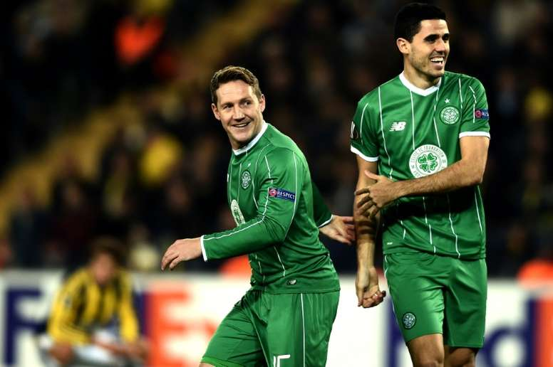 Celtics Kris Commons (L) and Tom Rogic celebrate after scoring a goal during an UEFA Europa League match in Istanbul, in December 2015